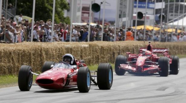 Goodwood 2014 Surtees and Raikkonen (LAT)